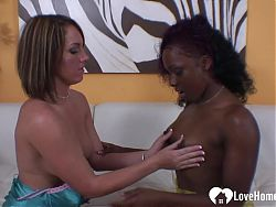 Interracial lesbians use a dildo during their session