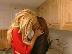 Blond and Brunette Kissing